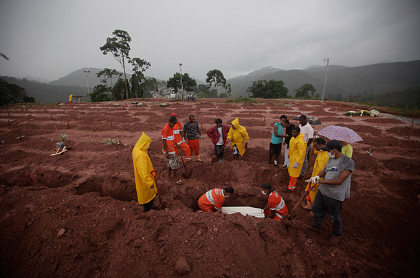 People mourn during the burial of a landslide victim in Teresopolis, Brazil.