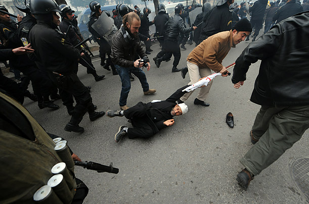Demonstrators clash with Tunisian security forces on Rome Avenue in Tunis.