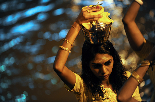 A Hindu devotee carries a milk pot, known as