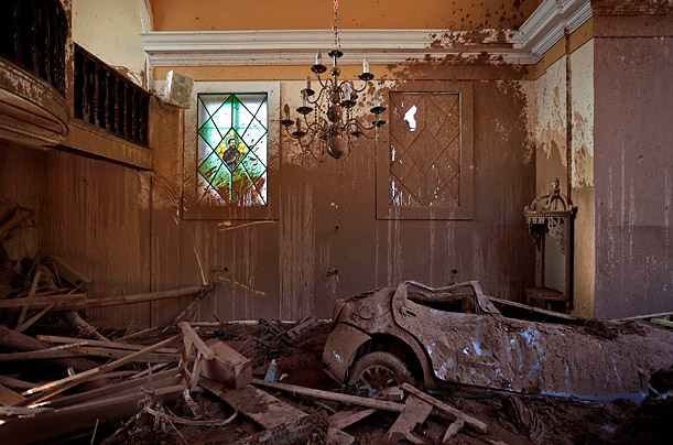 After being dragged by a mudslide this car came to rest inside a church in , Nova Friburgo, Brazil.