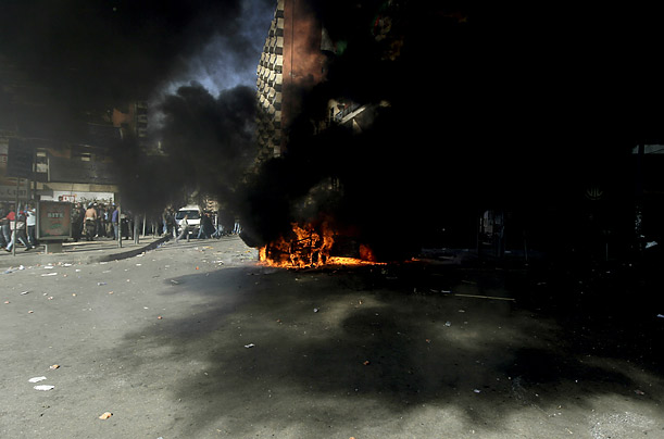 Protesters set fire to a truck belonging to Al-Jazeera, the Arab satellite television channel, during demonstrations in Lebanon.