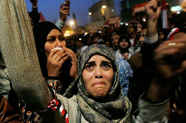 A woman cries in Tahrir Square after the announcement of President Hosni Mubarak's resignation.