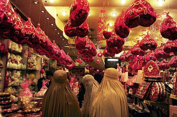 Veiled Pakistani women shop for Valentine's gifts in a shop in Peshawar.