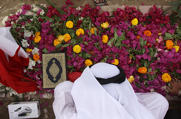 A man pays his respects at the grave of Abdel Redha Buhameed, who was killed during Bahrain's antigovernment protests.