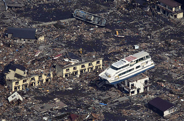 The tsunami left this yacht on top of a building in the mutilated town of Otsuchi, Japan.