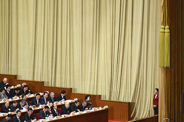 Delegates take their seats during the opening ceremony of the Chinese People's Political Consultative Conference at the Great Hall of the People in Beijing.