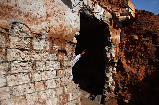 A man looks at underground prisons used by forces loyal to Libyan leader Muammar Gaddafi in Benghazi, Libya.