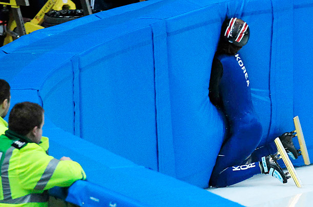 South Korea's Hwang Hyun-Sun crashes into a barrier during a training session for the World Short Track Speed Skating Championships at the Motorpoint arena in Sheffield, England. Hyun-Sun