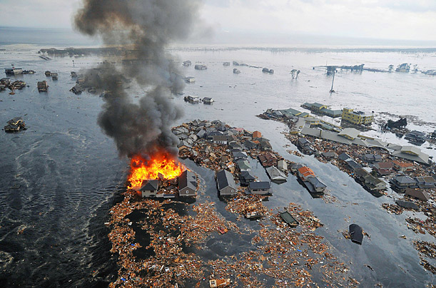 A fire burns after a massive earthquake, followed by a tsunami, devastated parts of northern Japan on March 11.
