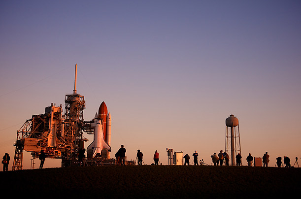 Photographers gather at sunrise to take pictures of the space shuttle Endeavorin Cape Canaveral, Florida.