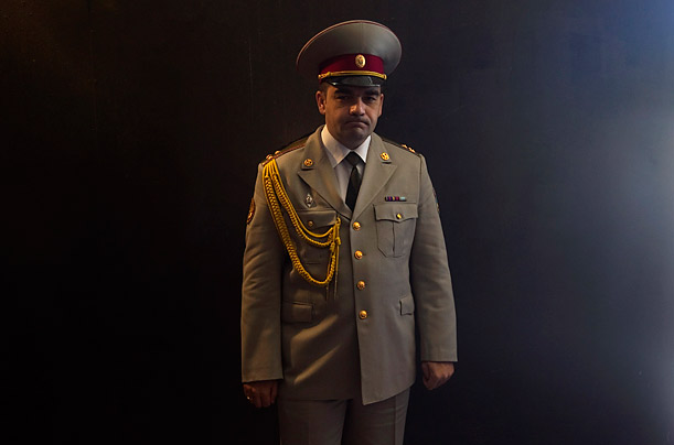 A Ukrainian military attache stands in the Hall of Remembrance at the Yad Vashem Holocaust Memorial in Jerusalem, before a ceremony with Ukraine's Prime Minister.