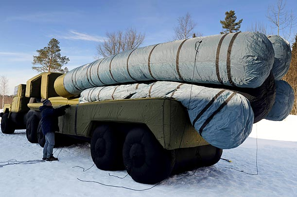 An inflatable replica of a Russian S-300 anti-aircraft missile launcher is filled with air outside the company workshop in Khotkovo, 37 miles northeast of Moscow.