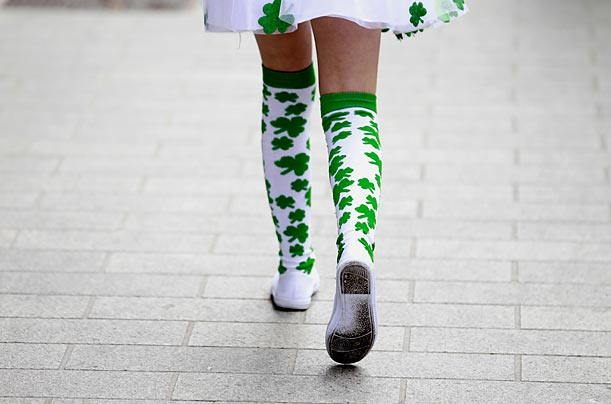 A girl in shamrock tights joins the  St Patrick's Day celebrations in Belfast, Northern Ireland.
