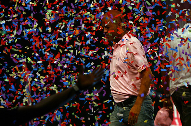 Haitian presidential candidate Michel Martelly is covered in confetti during a rally in downtown Port-au-Prince.