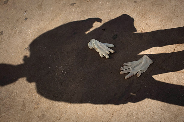 Used gloves from a morgue are seen on the ground outside al-Jalaa hospital in Benghazi, Libya.