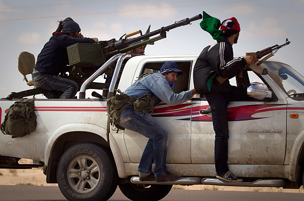 Libyan rebels retreat as mortars from Muammar Gaddafi's forces are fired on the outskirts of Ajdabiyah, Libya.