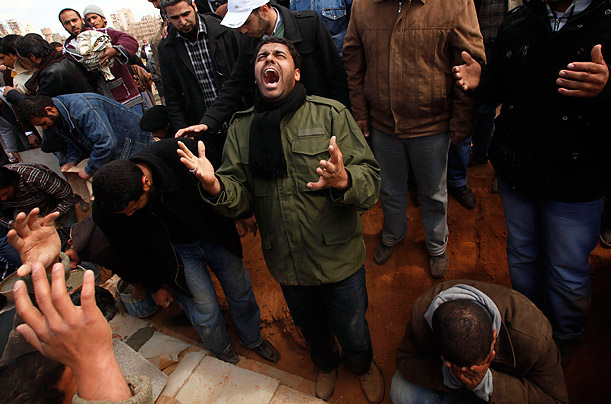 A man in Ajdabiyah reacts at a funeral of a fallen rebel who was killed by forces loyal to Colonel Muammar Gaddafi.
