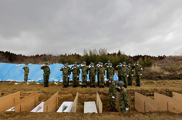 A temporary mass grave site is prepared by members of the Japan Ground Self Defense Force for the victims of the earthquake and tsunami in Higashi Matsushima, Japan.