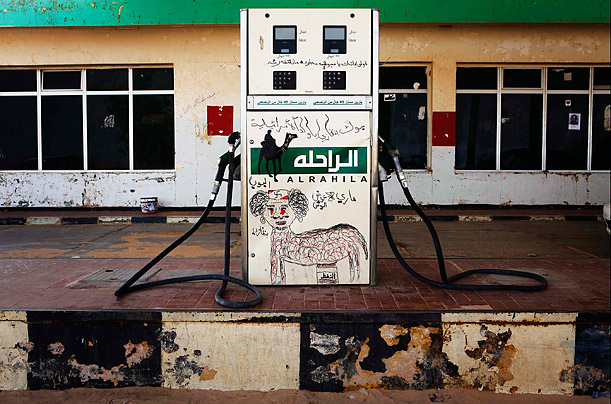 A fuel pump is defaced with a graffiti caricature of Muammar Gaddafi in the rebel-held town of Ajdabiyah, Libya.