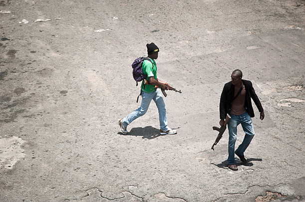 Pro-Gbagbo militiamen patrol in the empty streets of Abidjan as forces loyal to the internationally recognized President Alassane Ouattara approach the capital, Ivory Coast.