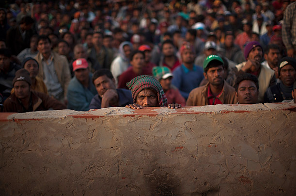 Bangladeshi men who once worked in Libya but fled the unrest wait to be called during a repatriation process at a refugee camp Ras Ajdir, Tunisia, on the Tunisia-Libya border.