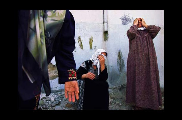 Women in the Jenin refugee camp in the West Bank react to a dead body after Israeli tanks leveled the area during a battle with Palestinian guerrillas