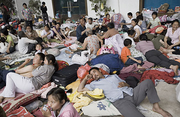 Photo: Survivors shelter in the Mianyang stadium. Ian Teh for TIME