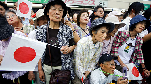 Supporters gather to listen to the Japanese Prime Minister and leader of the ruling Liberal Democratic Party (LDP) Taro Aso at a campaign rally near Tokyo on Aug. 25, 2009