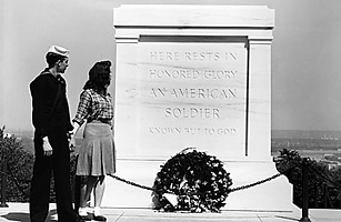 A couple walk by the Tomb of the Unknown Soldier