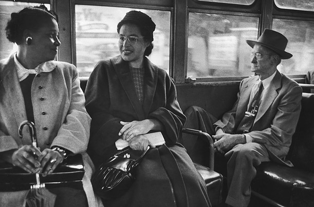 Rosa Parks, seated on a bus