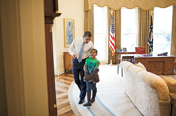 On a day off from school, Sasha stops by to say hello to her father in the Oval Office.