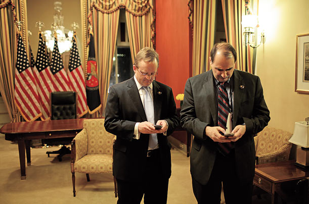 Robert Gibbs and David Axelrod check their Blackberrys as they wait with Obama in the Speaker's Office before the President addresses Congress.