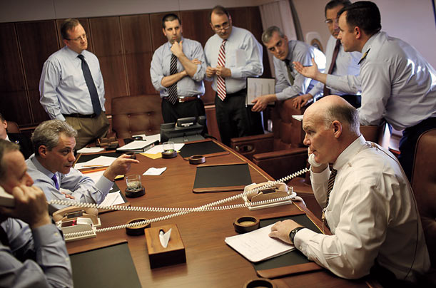Staffers finalize security details for the President on Air Force One before touching down in Baghdad.