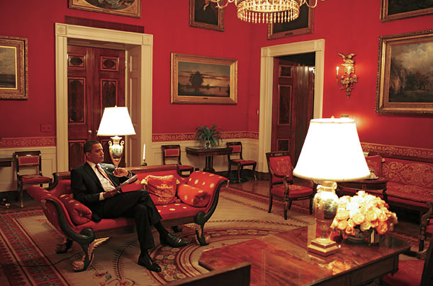 Obama checks the time before his second primetime televised press conference in March.