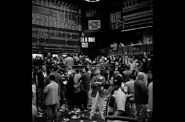 At the chicago mercantile exchange traders watch the open outcry in the sp 500 pit