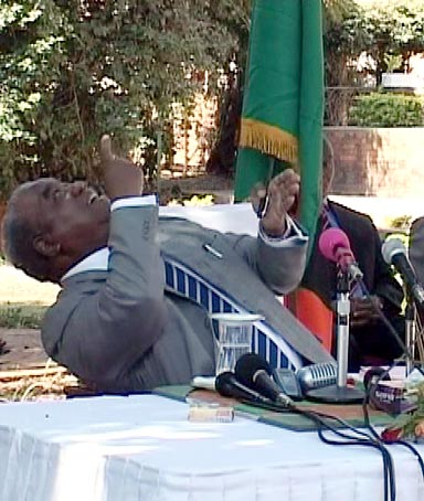 Zambian President Rupiah Banda reacting as a monkey urinates on him during a news conference.